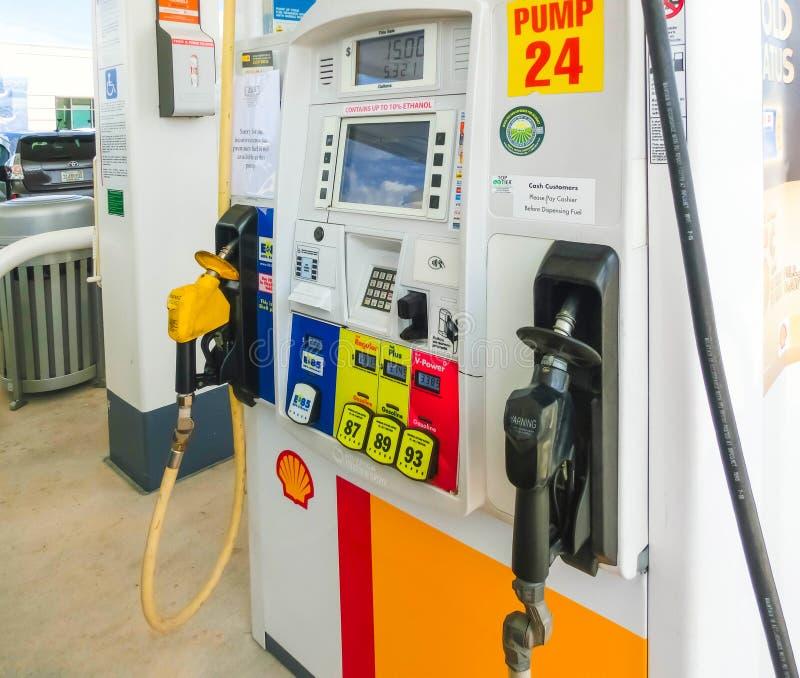 Orlando, USA - May 8, 2018: Filling nozzles at a Shell gas station. Orlando, USA - May 8, 2018: Filling nozzles at a Shell gas station at Orlando, USA on May 8 royalty free stock image