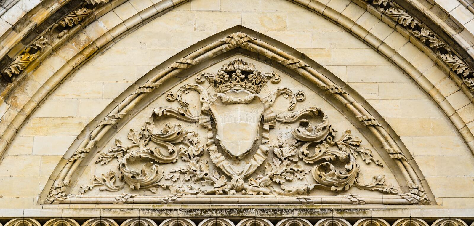 Facade of Cathedral of the Holy Cross of Orleans, Loire Valley,. Orleans, France: Detils of the carvings above the entrance doors of the Cathedral of the Holy royalty free stock image