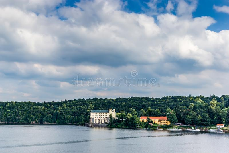 Orlik castle with blue sky and trees. stock photo