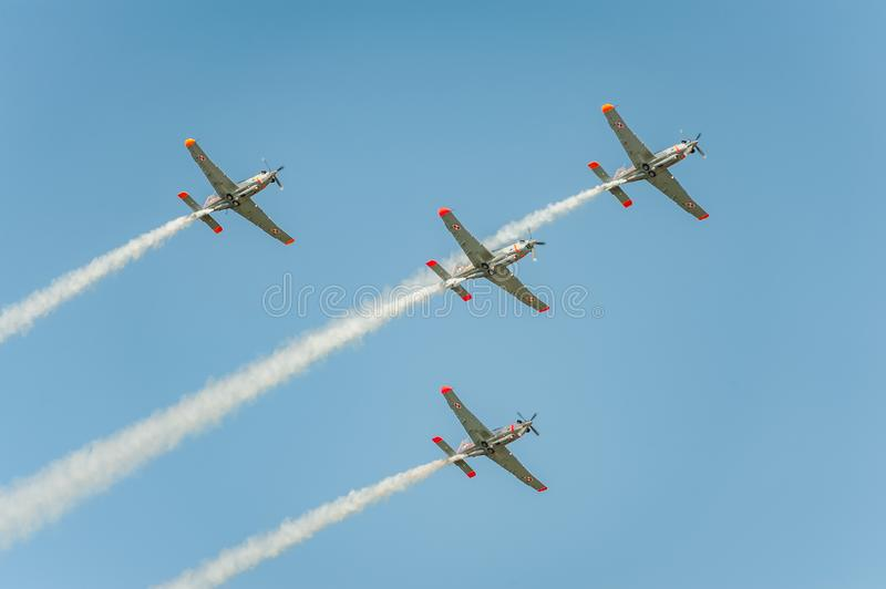 Orlik team shows great shows and leaves behind a smokes in the sky royalty free stock image