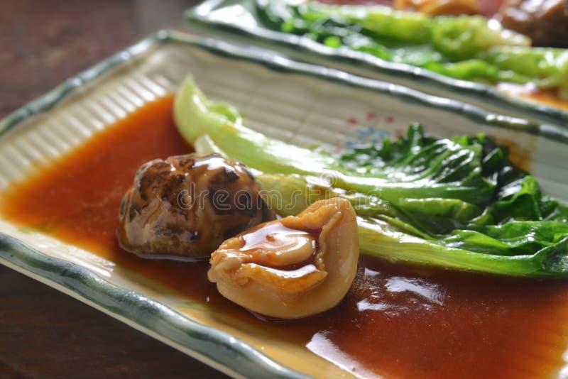 Ormeau cuit par champignon image stock