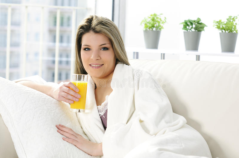Ornage Juice In Sofa Royalty Free Stock Image