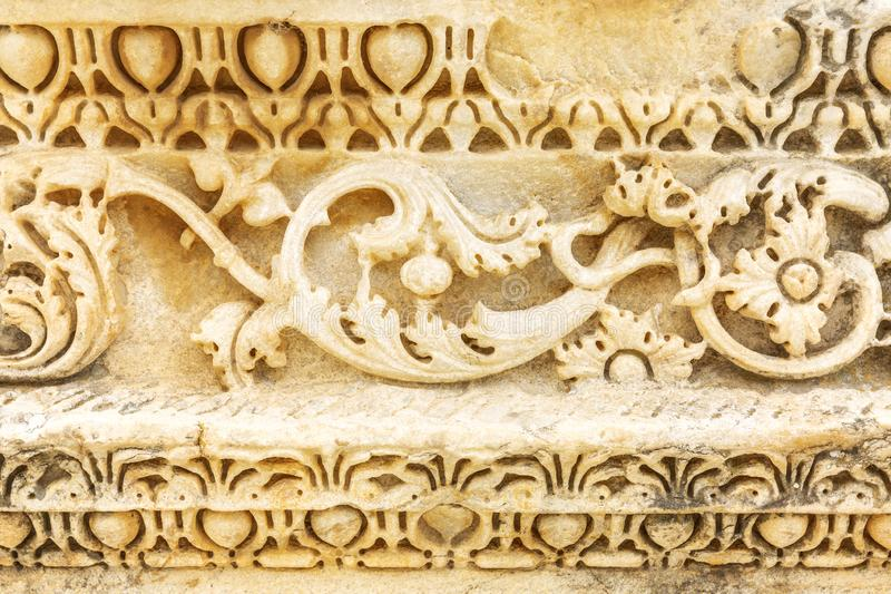 Ornament on antique construction. Texture, close-up. Horizontal royalty free stock images