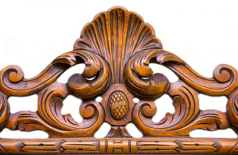 Ornament carved in wood. On white background stock photos