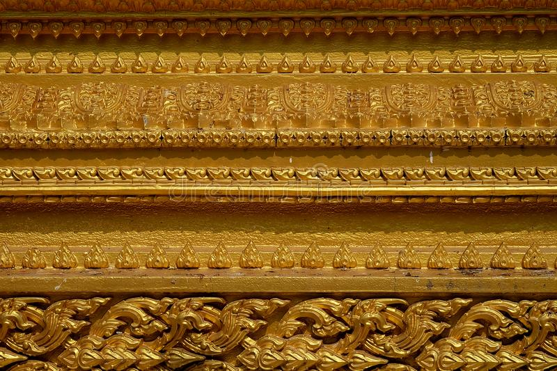 Ornament detail golden pattern stucco of Thailand style texture background from temple stock photo