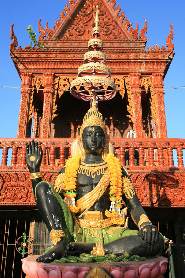 Ornament: Indra god statue with hand sign stock images