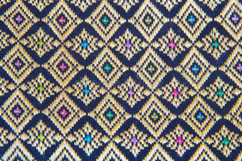 The ornament pattern on the wall Thai. window Lai Thai pattern. Bags of Souvenirs from Thailand. Design ethnic texture. Village ca stock image