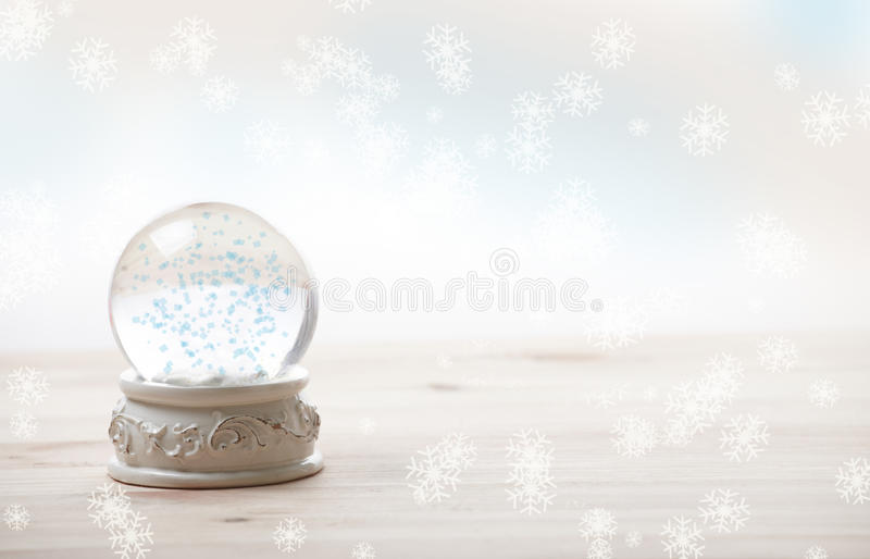 Ornament snow globe. Snow globe with snow flakes, beautiful ornament stock image