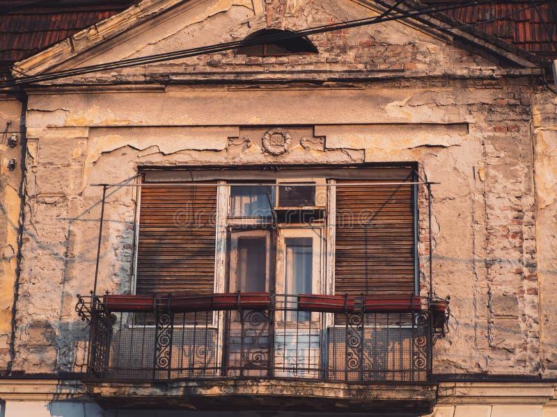Ornamental balcony on a old run down house stock photos