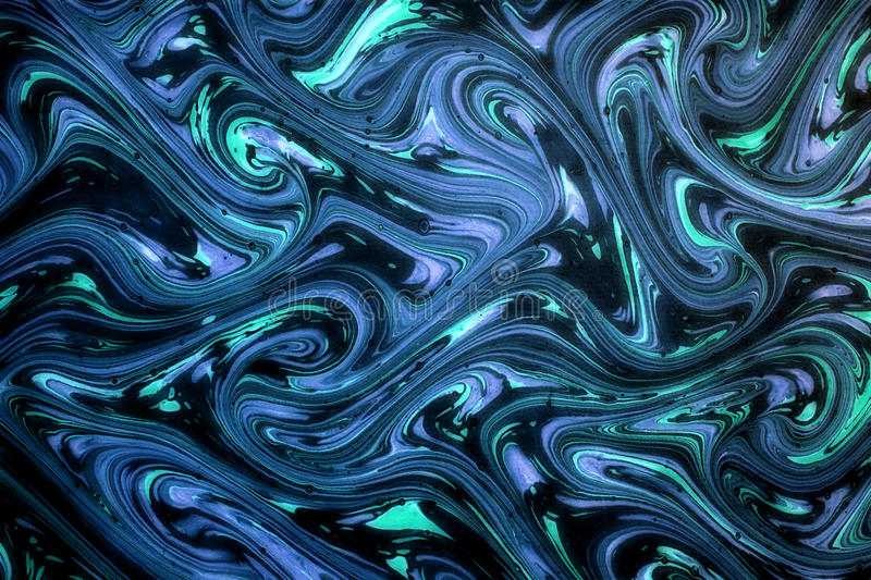 Ornamental blue swirling marbled paper royalty free stock photos