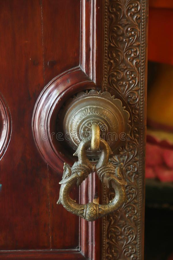 An ornamental door to a shrine stock photography