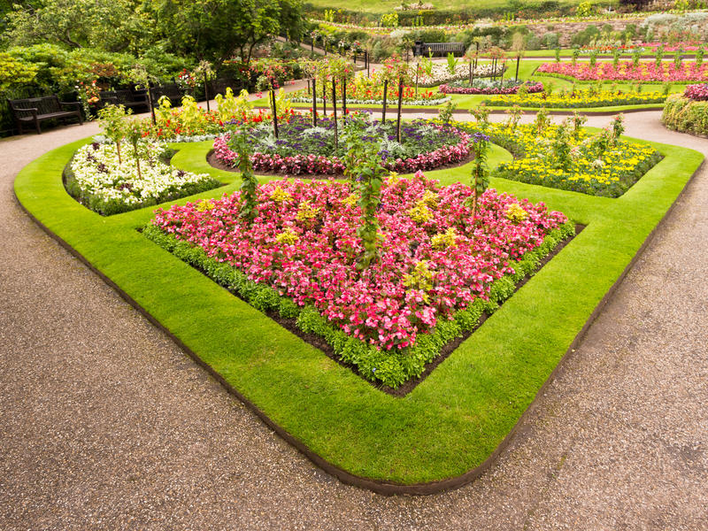 Ornamental Flower Bed. Colourful ornamental flower bed with grass border in a public garden in summer. the Dingle Gardens, Shrewsbury, Shropshire, England royalty free stock photography