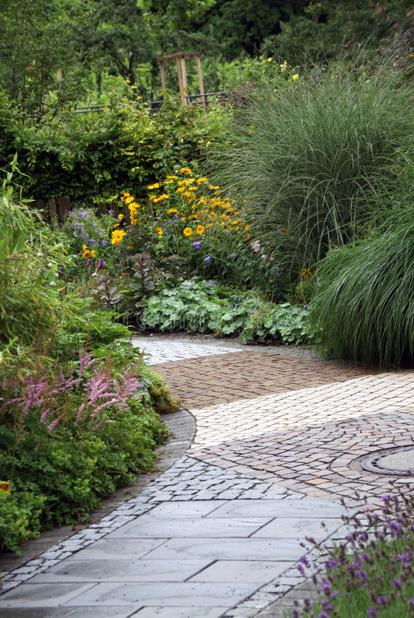 Ornamental garden path with perennial plants royalty free stock photos