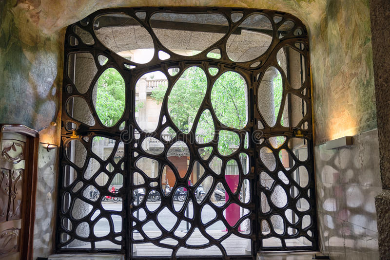 Ornamental gate on Case Mila - house designed by Antoni Gaudi in royalty free stock photos