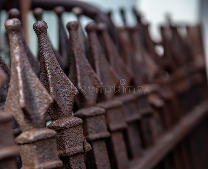 Ornamental iron fence with finials on top stock photo