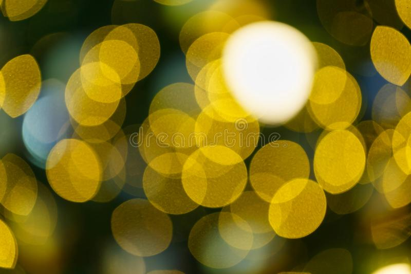 Ornamental lights/Light bulb/Abstract Light Bokeh Background. Winter holidays background/Soft golden lights Abstract bokeh background stock image