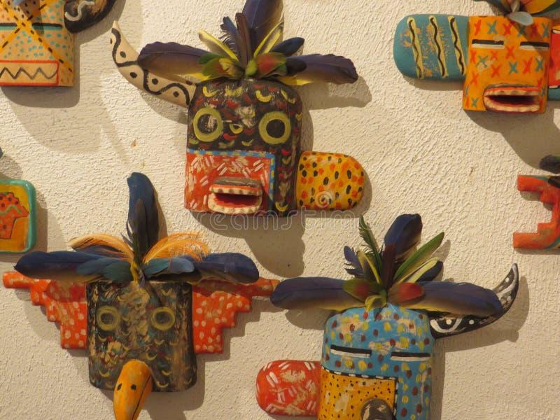 Ornamental masks, Santa Fe. Ornamental kachina-style masks adorn a shop wall in Santa Fe, New Mexico royalty free stock photography