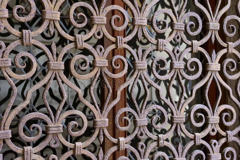 Ornamental metal frame of a window stock image