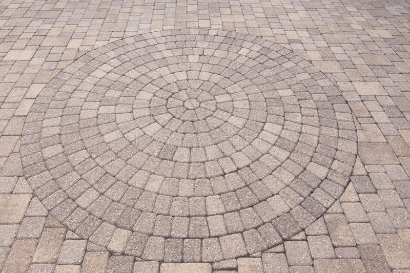 Ornamental pattern in patio paving stock photography