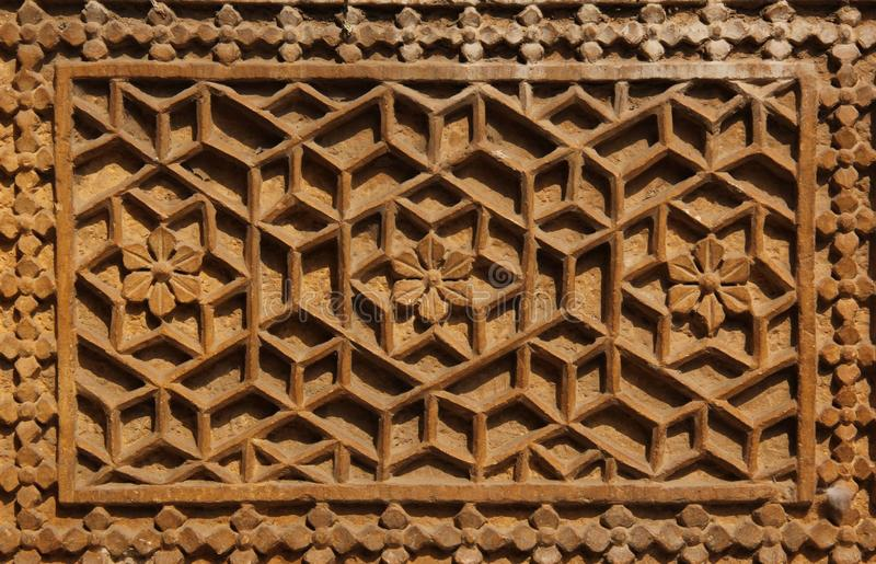 An ornamental pattern on a wall. An ornamental pattern decorates a wall in on of the building of Jaisalmer, India royalty free stock photos