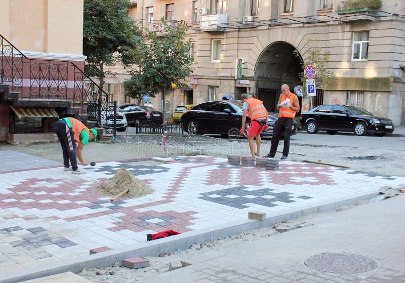 Ornamental pavement. Tile laying on the sidewalk. Kiev city streets decorated sidewalks - embroided. Zolotovorotsky travel. the city of Kiev. Ukraine royalty free stock photo