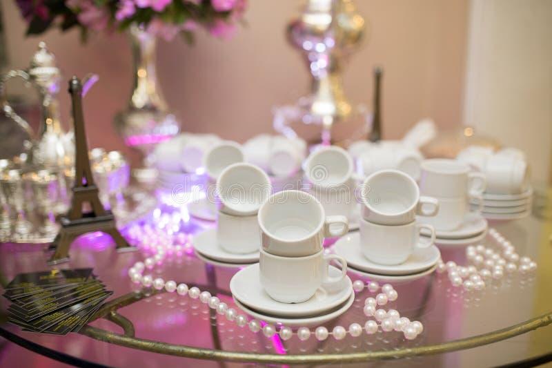 Ornamental tea set on glass table stock photo