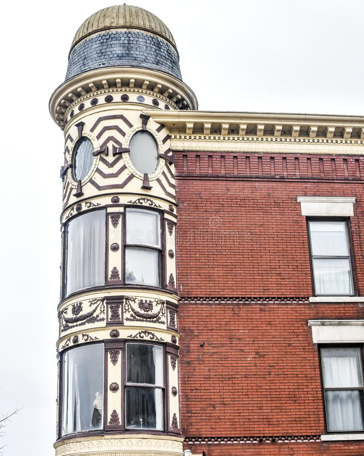 Ornamental Turret, Downtown Janesville, Wisconsin. An ornamental turret on the facade of a restored, old brick building in downtown Janesville, WI. There is a royalty free stock images