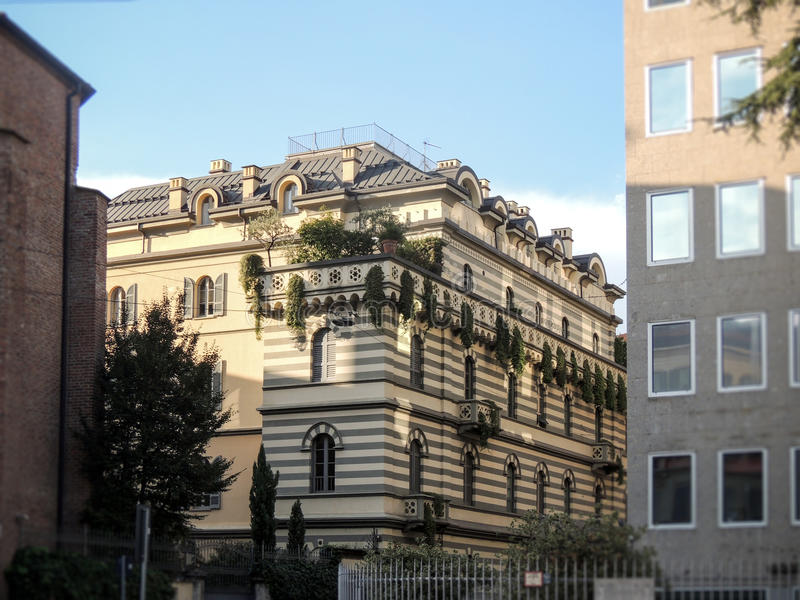 Ornamented building in Milan. An ornamented building in the center of Milan royalty free stock image