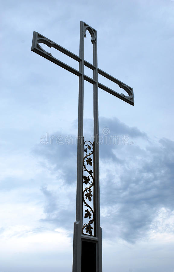 Ornamented cross. Detail of the ornamented metal cross against a blue sky. Travel Poland stock images
