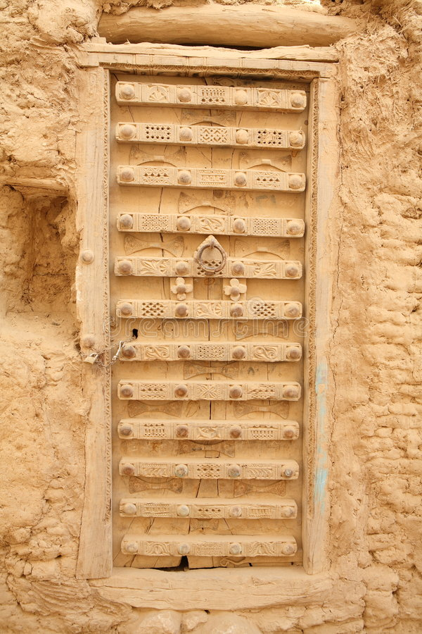 Ornamented door from Yemen. Design of old masters of Hadramaut region royalty free stock photo