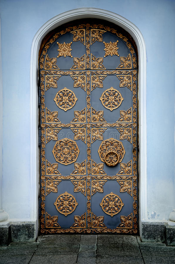 Ornamented gold door. And blue walls royalty free stock photo