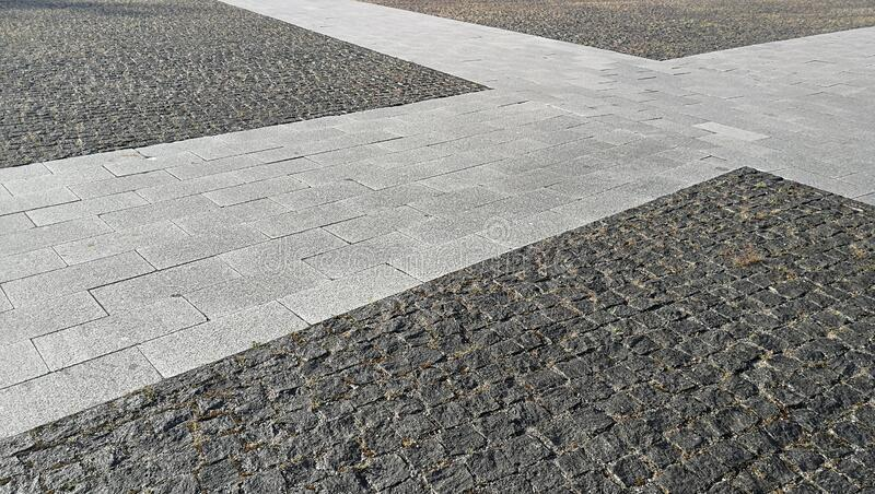 Pavement tiles - combined dark gray and light gray stone tiles royalty free stock images