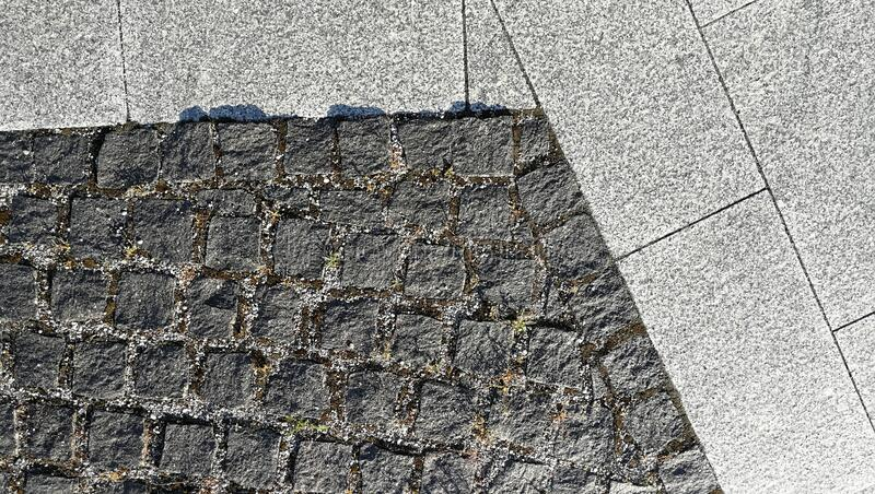 Pavement tiles - combined dark gray and light gray stone tiles stock photography