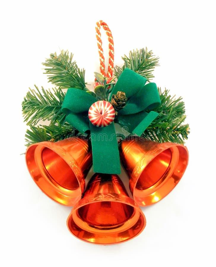 Ornamento de la Navidad con las alarmas de mano fotografía de archivo