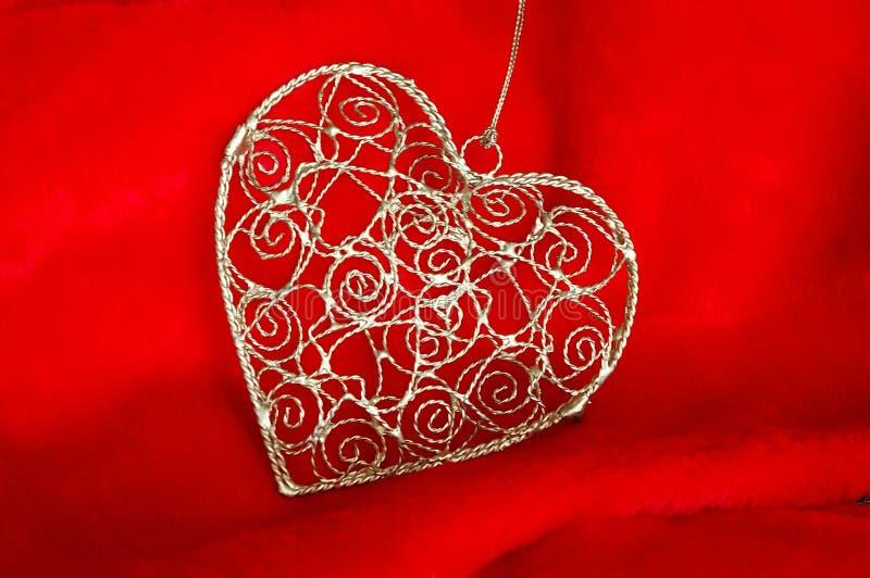 Ornamento de la Navidad del corazón del oro imágenes de archivo libres de regalías