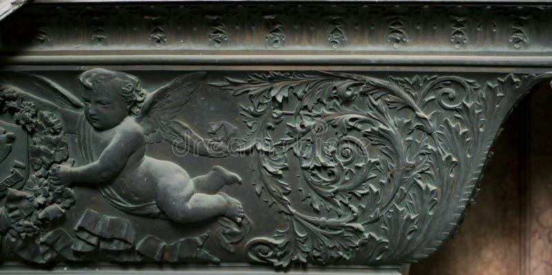 Ornamento de pedra do cupido fotografia de stock royalty free