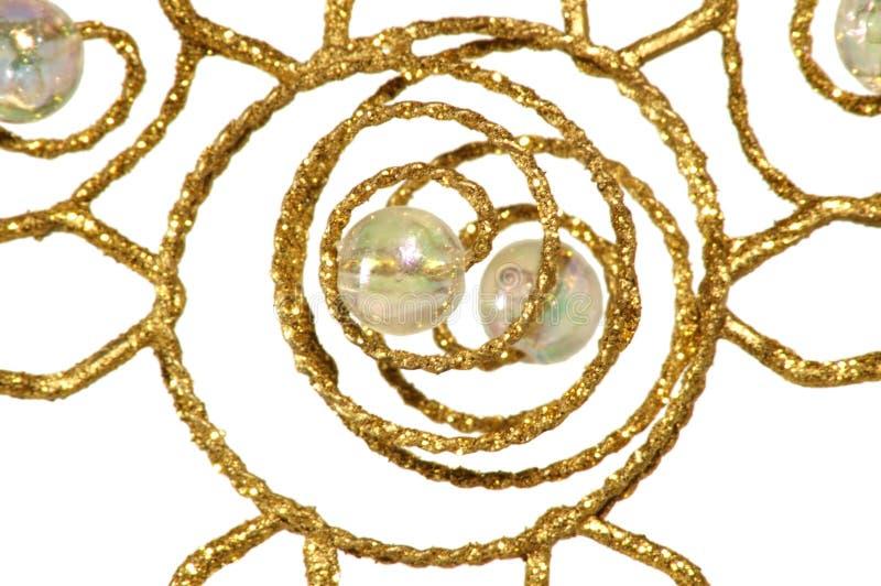 Ornamento do Natal - sumário dourado, no branco imagens de stock royalty free