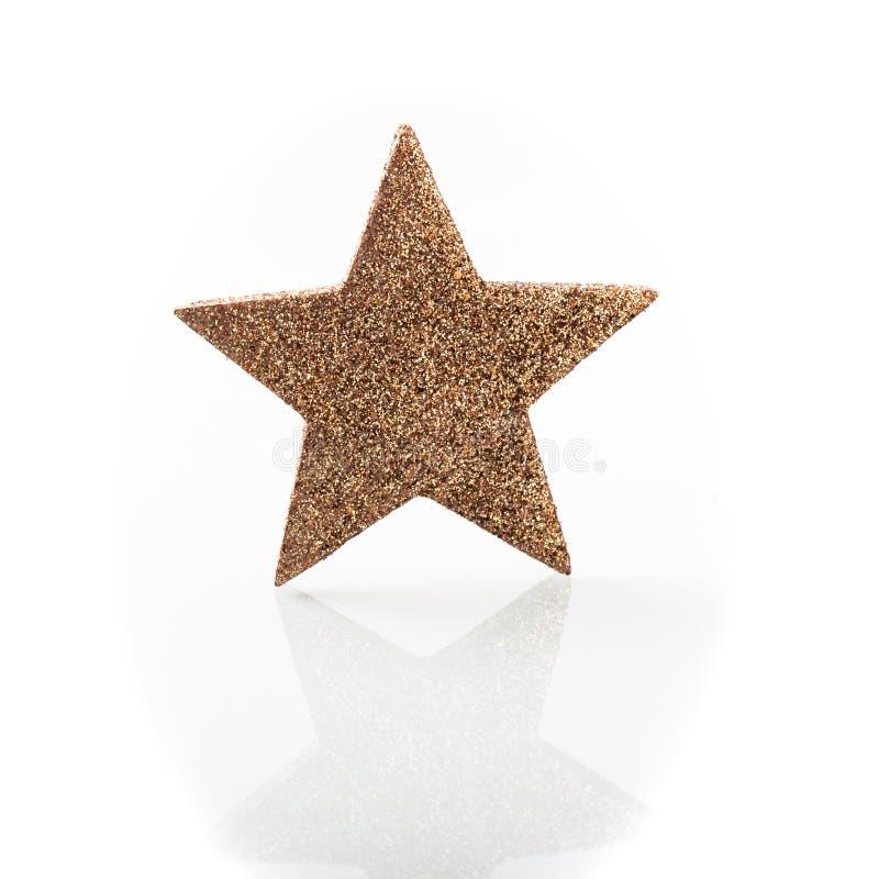 Ornamento dorato della decorazione di Natale della stella fotografia stock libera da diritti