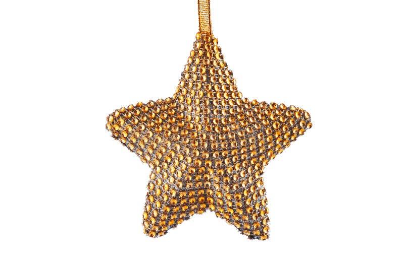 Ornamento dourado da estrela do Natal na fita isolada no backg branco imagens de stock royalty free