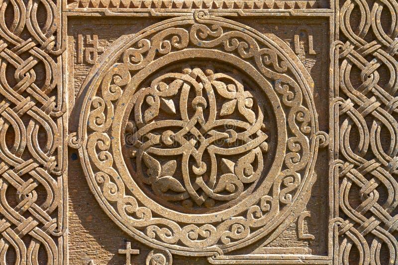 Ornamento medievale armeno sulla pietra fotografia stock