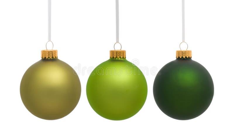 Ornamentos colgantes verdes de la Navidad imagen de archivo libre de regalías