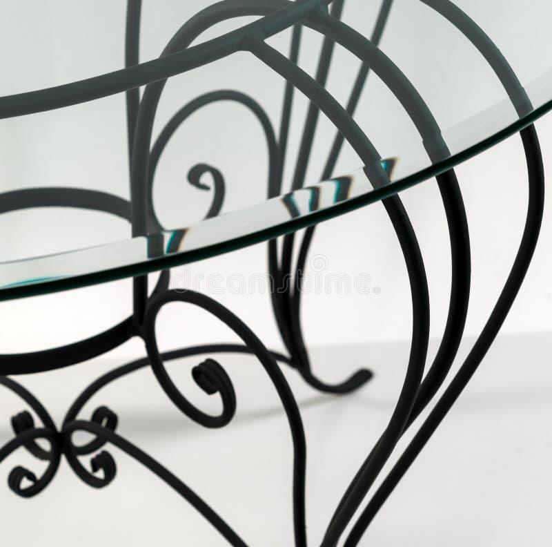 Ornamentos curvados del hierro labrado Detalle de la tabla fotografía de archivo