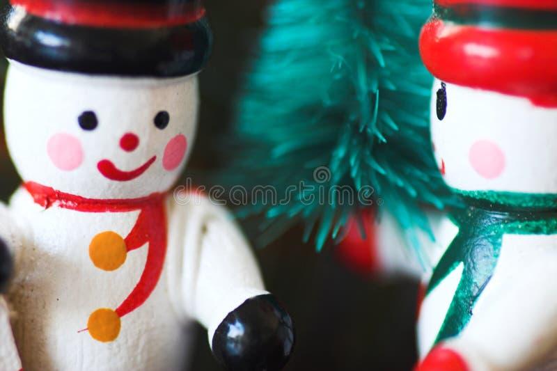 Ornamentos de madera de la Navidad del muñeco de nieve fotografía de archivo libre de regalías