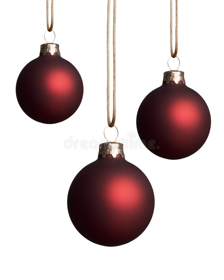 Ornamentos rojos colgantes de la Navidad fotografía de archivo libre de regalías