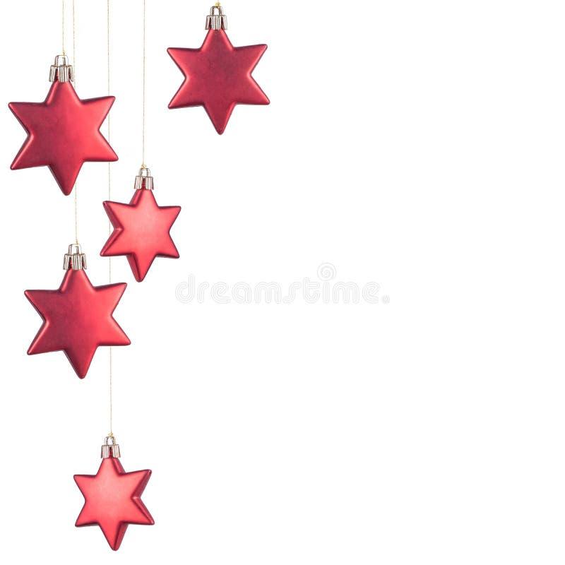 Ornamentos rojos de la Navidad foto de archivo