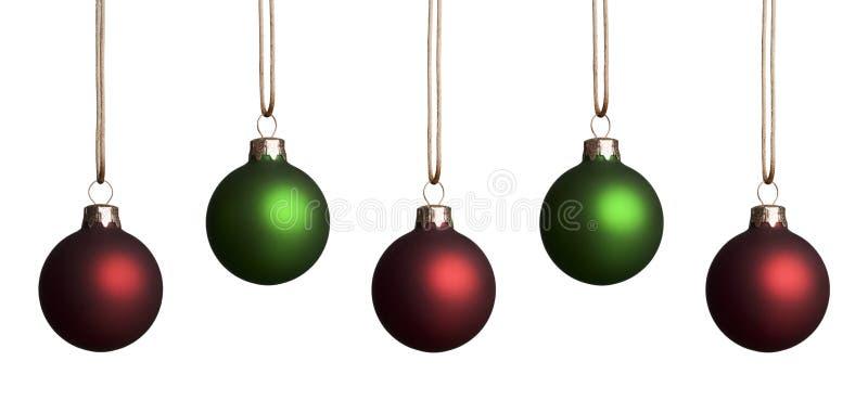 Ornamentos rojos y verdes foto de archivo libre de regalías