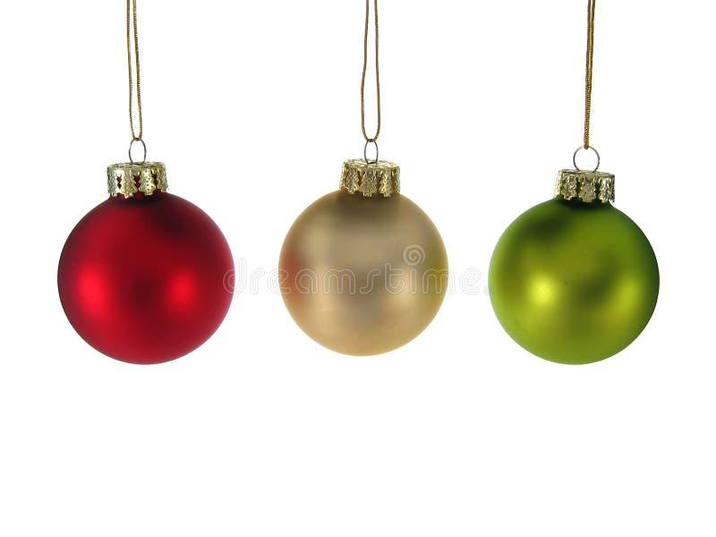 Ornamentos verdes de plata rojos de la Navidad aislados. fotos de archivo