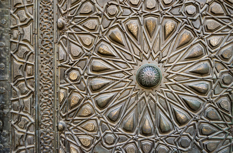 Ornaments of the bronze-plate door of an old mosque, Old Cairo,. Ornaments of the bronze-plate door of a historic mosque, Old Cairo, Egypt royalty free stock images