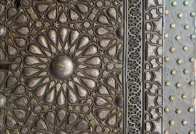 Ornaments of the bronze-plate ornate door, Manial Palace of Prince Mohammed Ali Tewfik, Cairo, Egypt. Ornaments of the bronze-plate ornate door of the residence royalty free stock images