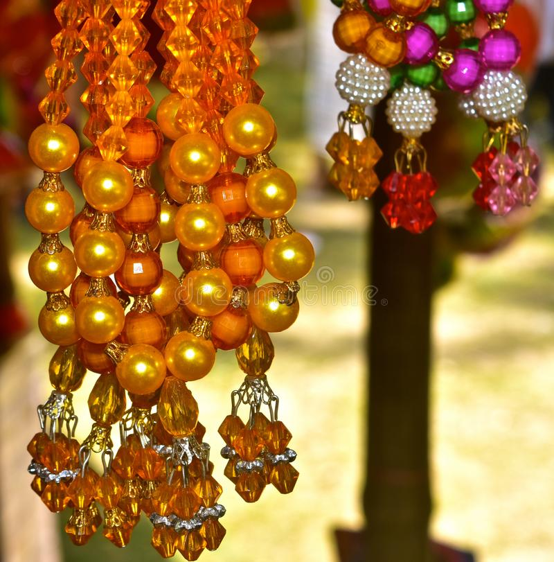 Ornaments for Ladies Fashion Use Background Photograph. The yellow coloured stylish modern ladies use fashionable ornaments background photograph royalty free stock image